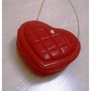 Стильная женская сумочка в виде сердечка